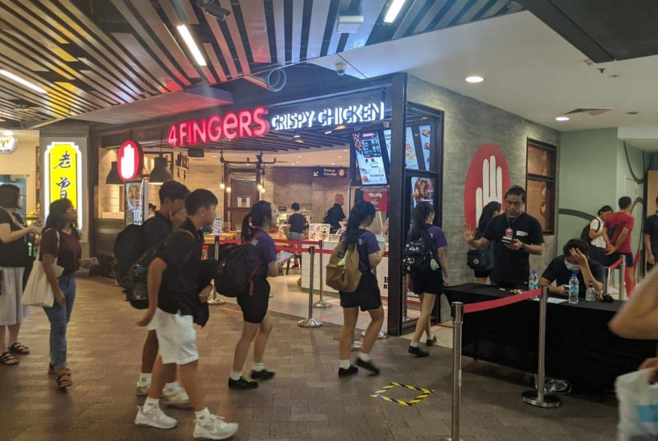 Patrons queueing to get into an area of Causeway Point on 27 March, 2020. (PHOTO: Wong Casandra/Yahoo News Singapore)