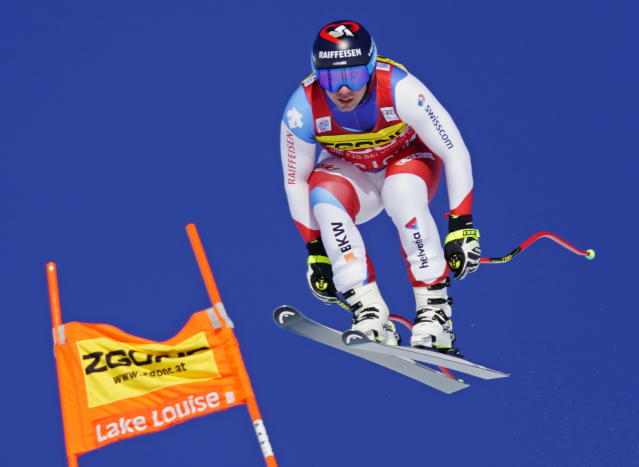 Beat Feuz of Switzerland skis down the course during the men's World Cup downhill ski race in Lake Louise, Alberta, Canada, on Saturday, Nov. 30, 2019. (Frank Gunn/The Canadian Press via AP)