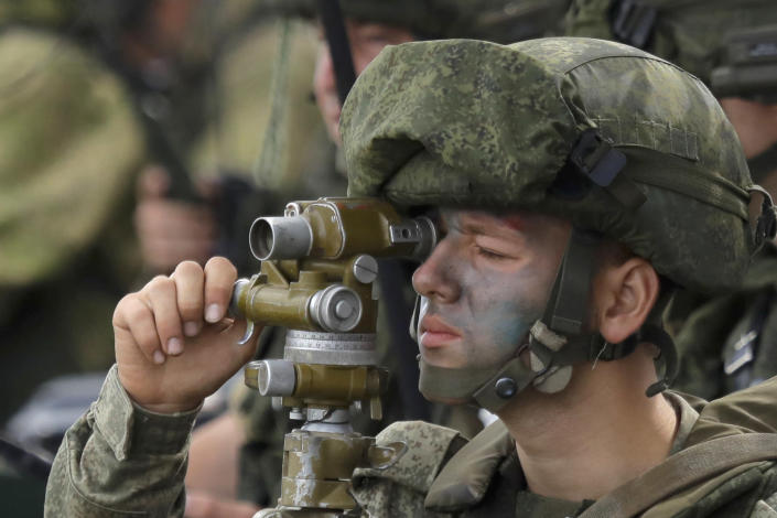 """A Russian officer watches through a rear sight during Russian military maneuvers Vostok 2018 on the training ground """"Klerk,"""" about 50 kilometers (31 miles) south of Vladivostok, Russian Far East port, Russia, Saturday, Sept. 15, 2018. The weeklong Vostok 2018 maneuvers are the largest war games Russia ever had. (AP Photo/Sergei Grits)"""
