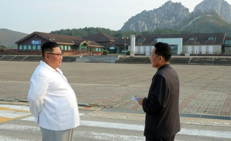 North Korean leader Kim Jong Un (C) inspected the Mount Kumgang tourist area in 2019 and described it as an eyesore