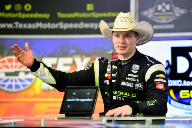 American Josef Newgarden had to wait out a four and a half hour start delay before weaving his way through the field to win the IndyCar Series Iowa 300 race