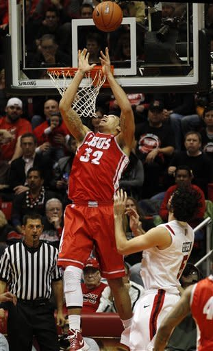 New Mexico forward Drew Gordon cannot handle the pass on an attempted dunk against San Diego State during the first half of an NCAA basketball game on Wednesday, Feb. 15, 2012, in San Diego. (AP Photo/Lenny Ignelzi )