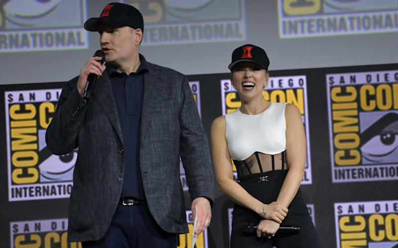 President of Marvel Studios Kevin Feige (L) and US actress Scarlett Johansson speak on stage for the Marvel panel in Hall H of the Convention Center during Comic Con in San Diego - AFP