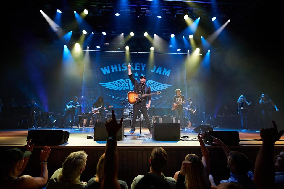 """<p>Chris Young singing his most recent multi-week chart-topping hit """"Famous Friends,"""" a fitting song for a night filled with nearly two-dozen stars of country & more. </p>"""