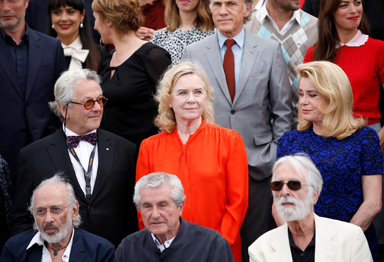 70th Cannes Film Festival - Photocall for the 70th Anniversary of the festival - Cannes, France. 23/05/2017. Jury members of the 70th Cannes festival, former Cannes festival award winners, actors and directors pose for a family picture. L-R top, George Miller, Liv Ullmann, Catherine Deneuve, L-R bottom : Jerry Schatzberg, Claude Lelouch, Michael Haneke .   REUTERS/Stephane Mahe