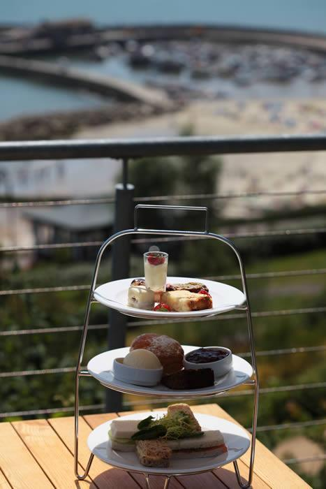 "<p>Sip your brew to the sound of the ocean at The Alexandra. Tea can be served in the conservatory of the cliff-top hotel, looking out over the bay of Lyme Regis. A spread of scones, cream, jam, sandwiches, tea and cake costs £19.50 per person. </p><p><a rel=""nofollow noopener"" href=""http://www.hotelalexandra.co.uk/"" target=""_blank"" data-ylk=""slk:Hotelalexandra.co.uk"" class=""link rapid-noclick-resp""><b>Hotelalexandra.co.uk</b></a></p>"