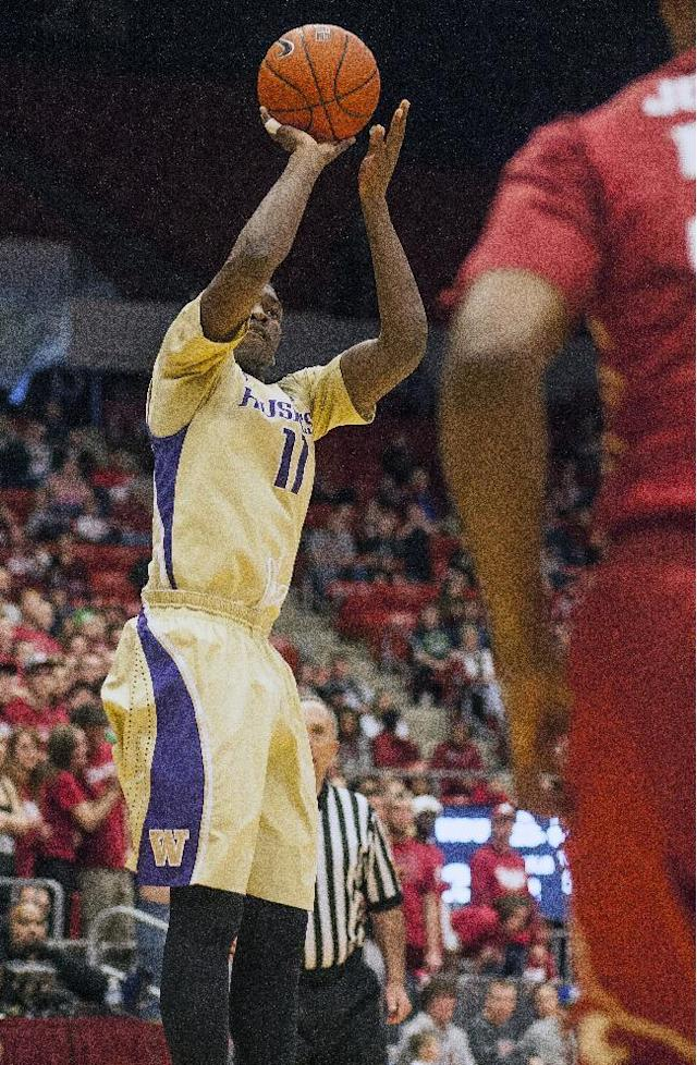Washington guard Mike Anderson (11) scores on this 3-point shot against Washington State during the first half of an NCAA college basketball game, Saturday, Feb. 1, 2014, in Pullman, Wash. (AP Photo/Dean Hare)