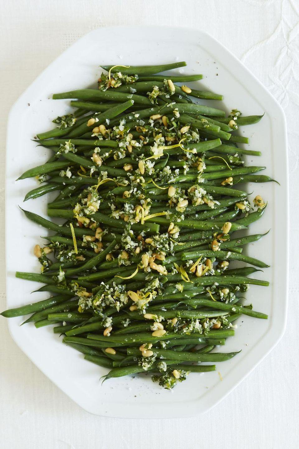 """<p>If you're a lover of veggie sides, then get a taste of this cheesy and bright classic dish.<br><br><em><a href=""""https://www.goodhousekeeping.com/food-recipes/a15467/green-beans-gremolata-recipe-ghk1113/"""" rel=""""nofollow noopener"""" target=""""_blank"""" data-ylk=""""slk:Get the recipe for Green Beans Gremolata »"""" class=""""link rapid-noclick-resp"""">Get the recipe for Green Beans Gremolata »</a></em><br></p>"""