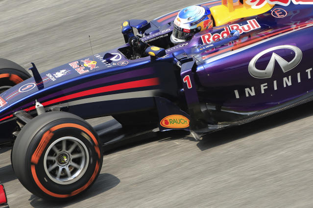 Red Bull driver Sebastian Vettel of Germany steers his car during the second practice session for the Malaysian Formula One Grand Prix at Sepang International Circuit in Sepang, Malaysia, Friday, March 28, 2014. (AP Photo/Peter Lim)