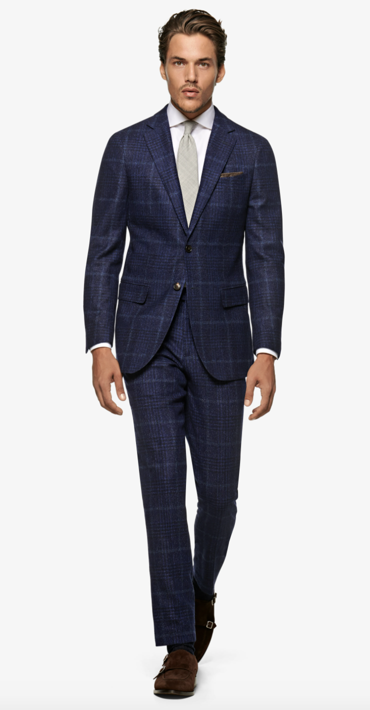 """<p><strong>Suitsupply</strong></p><p>suitsupply.com</p><p><strong>$320.00</strong></p><p><a href=""""https://outlet-us.suitsupply.com/en_US/suits/navy-check-sienna-suit/P5524.html"""" rel=""""nofollow noopener"""" target=""""_blank"""" data-ylk=""""slk:Buy"""" class=""""link rapid-noclick-resp"""">Buy</a></p>"""