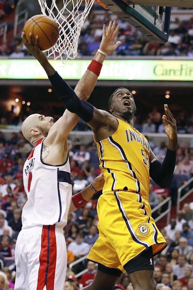 Indiana Pacers center Roy Hibbert (55) shoots under pressure form Washington Wizards center Marcin Gortat of Poland during the second half of Game 3 of an Eastern Conference semifinal NBA basketball playoff game in Washington, Friday, May 9, 2014. (AP Photo/Alex Brandon)