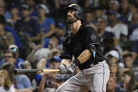 Miami Marlins' Jon Berti watches his three-run home run during the sixth inning of the team's baseball game against the Chicago Cubs in Chicago, Friday, June 18, 2021. (AP Photo/Nam Y. Huh)