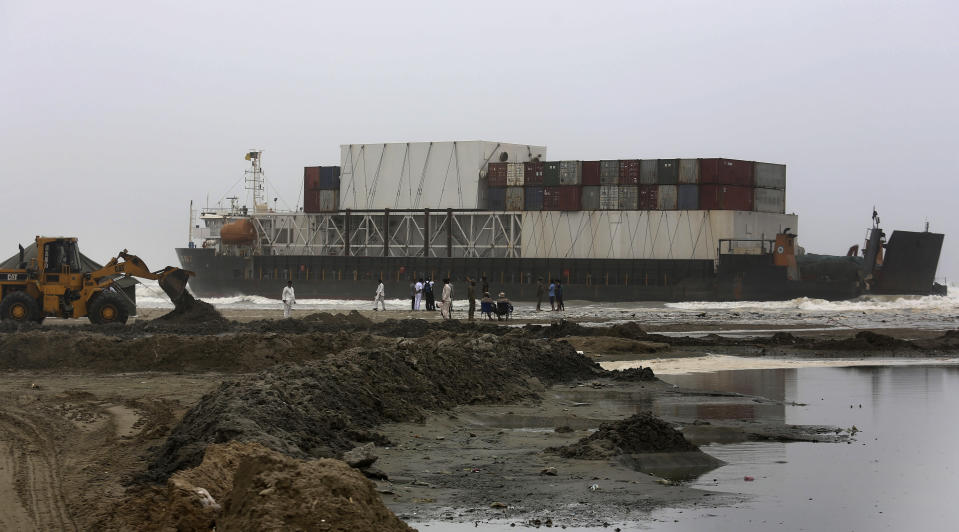 Officials of the Karachi Port Trust and Pakistan Navy prepare to conduct an operation for refloating the stranded Heng Tong 77 cargo ship at Sea View Beach near the southern port city of Karachi, Pakistan, Monday, July 26, 2021. Pakistani authorities said they are working on plans to refloat the cargo ship that ran aground last week amid bad weather en route to Istanbul from China. (AP Photo/Fareed Khan)