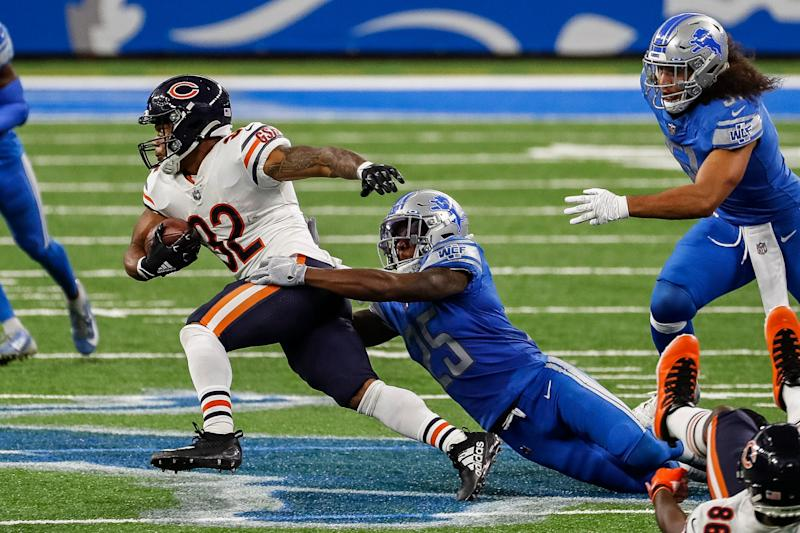 Lions safety Will Harris tries to stop Bears running back David Montgomery during the first half at Ford Field on Sunday, Sept. 13, 2020.