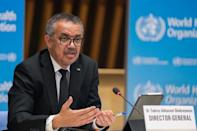This handout picture taken and released on February 12, 2021 by the World Health Organization, shows WHO Director-General Tedros Adhanom Ghebreyesus speaking to reporters in Geneva about the agency's recent Covid-19 mission in China