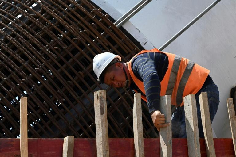 A Chinese laborer works in 2020 at a Chinese-funded project in Port City in Colombo, Sri Lanka, where Secretary of State Mike Pompeo will warn of risks of ties with Beijing