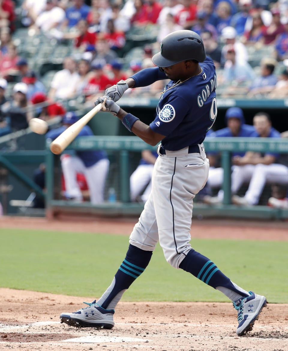 Seattle Mariners' Dee Gordon follows through on a two-run single that came off pitch from Texas Rangers' Brett Martin in the first inning of a baseball game in Arlington, Texas, Sunday, Sept. 1, 2019. (AP Photo/Tony Gutierrez)