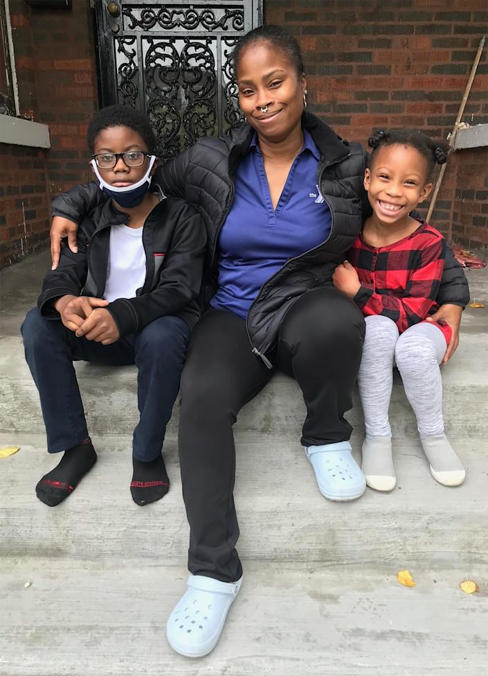 Image: Tahiti Hamer and her children in front of their home in the South Shore neighborhood in Chicago. (Courtesy Tahiti Hamer)