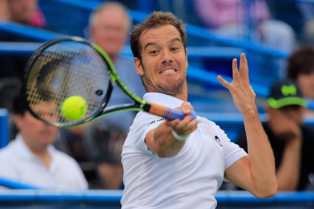 Richard Gasquet of France returns a shot to Kei Nishikori of Japan during the Citi Open at the William H.G. FitzGerald Tennis Center on August 1, 2014 in Washington, DC (AFP Photo/Rob Carr)