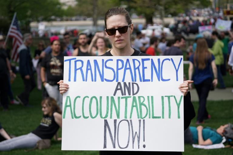 "Protestors take part in the ""Tax March"" to call on US President Donald Trump to release his tax records on April 15, 2017 in Washington, DC"
