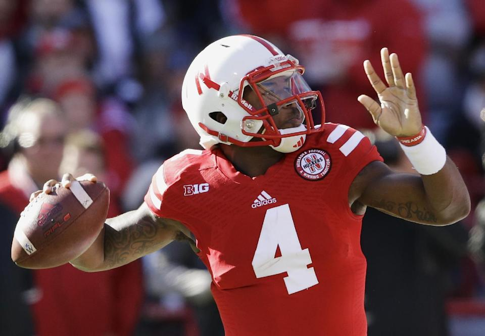 Nebraska quarterback Tommy Armstrong Jr. (4) throws in the first half of an NCAA college football game against Purdue in Lincoln, Neb., Saturday, Nov. 1, 2014. (AP Photo/Nati Harnik)