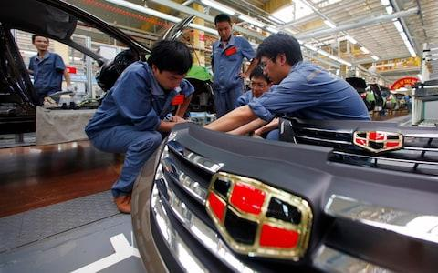 Employees check plastic bumpers along a Geely Automobile Corporation assembly line in Cixi...Employees check plastic bumpers along a Geely Automobile Corporation assembly line in Cixi, Zhejiang province June 21, 2012. Car sales in China rose 22.6 percent in May from a year earlier, the China Association of Automobile Manufacturers (CAAM) said on June 9. REUTERS/Carlos Barria