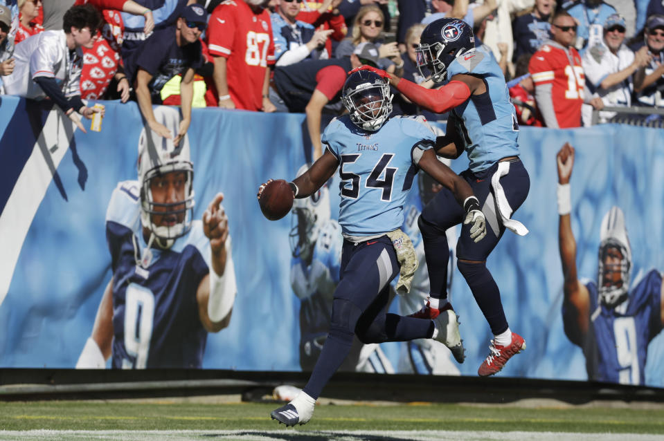 Tennessee Titans inside linebacker Rashaan Evans (54) celebrates with Kevin Byard (31) after Evans ran back a fumble 53 yards for a touchdown against the Kansas City Chiefs in the first half of an NFL football game Sunday, Nov. 10, 2019, in Nashville, Tenn. (AP Photo/James Kenney)