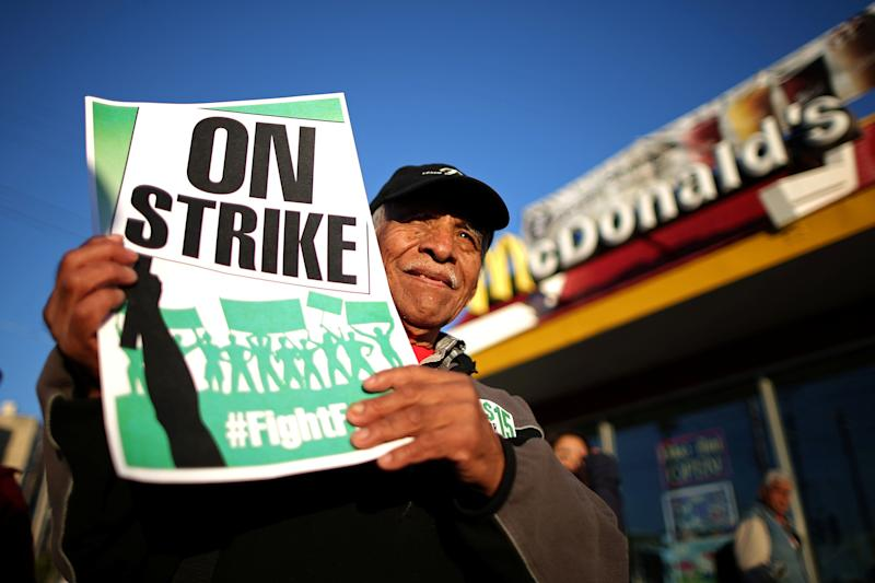 Fast-food workers with the Fight for $15 campaign have rallied in cities around the country for higher minimum wages. (Photo: Lucy Nicholson / Reuters)