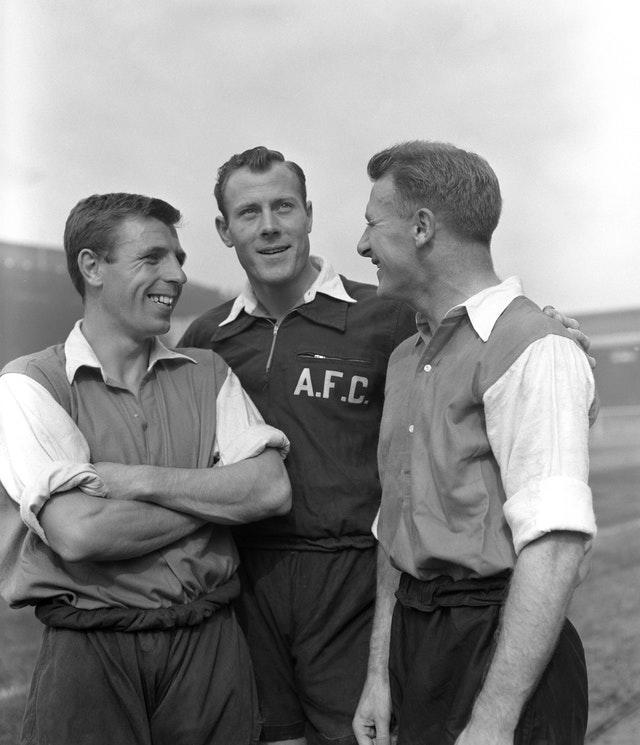Tommy Docherty (right) after signing for Arsenal from Preston