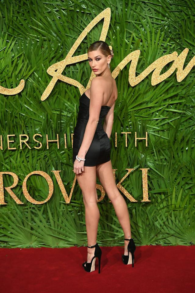 <p>Hailey Baldwin proves the high street can work wonders on the red carpet as she chose a Topshop mini dress for the fashion ceremony. <em>[Photo: Getty]</em> </p>