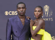 Paapa Essiedu, left, and Michaela Coel arrive at the 73rd Primetime Emmy Awards on Sunday, Sept. 19, 2021, at L.A. Live in Los Angeles. (AP Photo/Chris Pizzello)