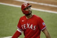 Texas Rangers outfielder Joey Gallo looks up at a replay after flying out in the fifth inning of a baseball game against the Los Angeles Dodgers in Arlington, Texas, Sunday, Aug. 30, 2020. (AP Photo/Roger Steinman)