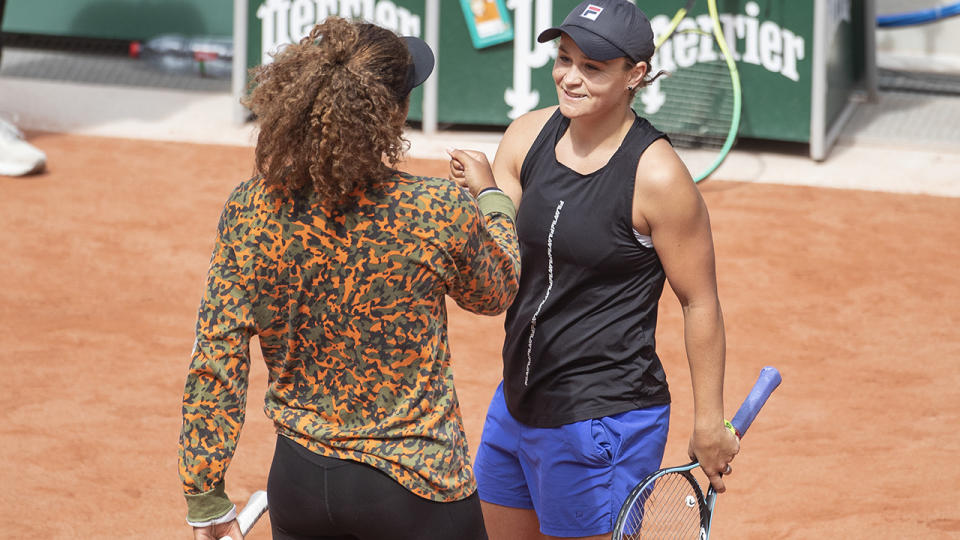 Naomi Osaka and Ash Barty, pictured here on the practice court at the French Open.