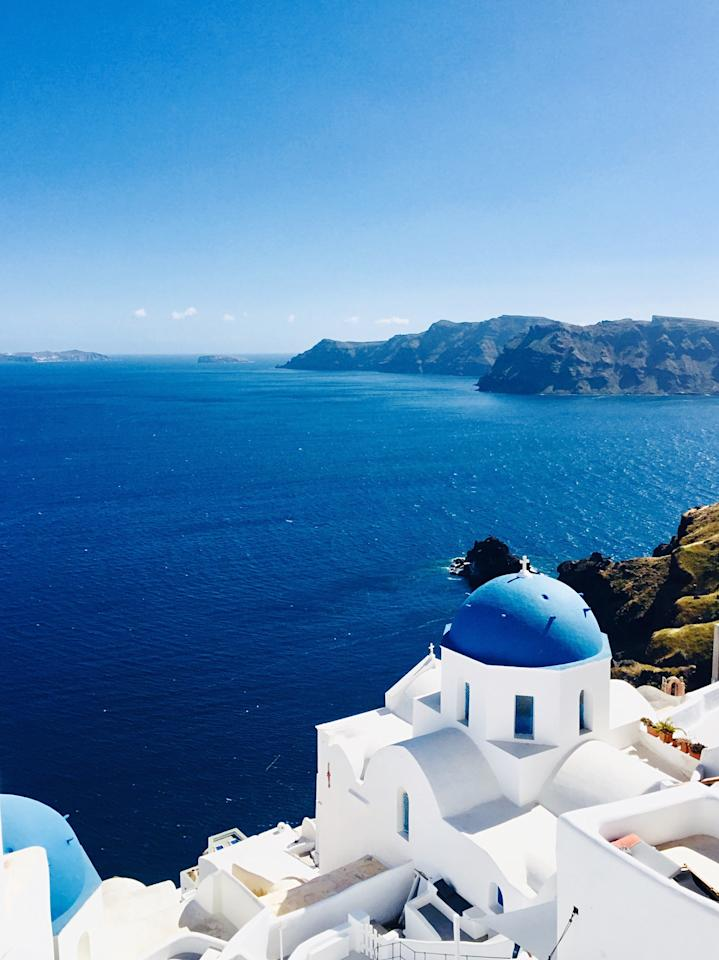"Pantone's deep blue appears all over Santorini, standing out against the island's <a href=""https://www.cntraveler.com/story/for-the-real-santorini-visit-during-off-season?mbid=synd_yahoo_rss"" target=""_blank"">bright white buildings</a>. It's reflected on Santorini's roofs, doors, and in the Aegean Sea below."