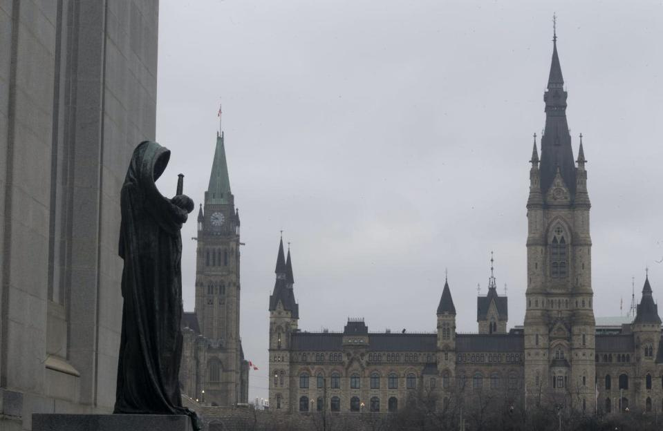 The statue representing justice looks out from the Supreme Court of Canada
