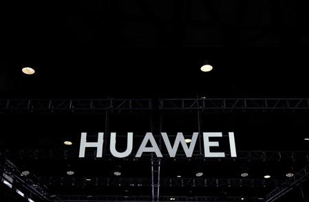 FILE PHOTO: A Huawei company logo is seen at CES (Consumer Electronics Show) Asia 2019 in Shanghai