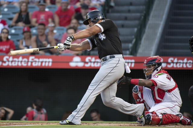 Chicago White Sox' Jose Abreu hits a solo home run during the first inning of a baseball game against the Los Angeles Angels in Anaheim, Calif., Monday, July 23, 2018. (AP Photo/Kyusung Gong)