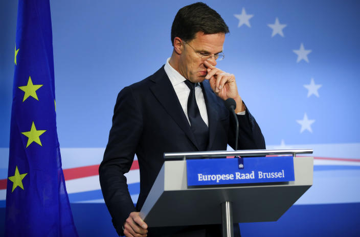 FILE - In this Friday, Feb. 21, 2020 file photo, Dutch Prime Minister Mark Rutte speaks during a media conference at the end of an EU summit in Brussels. European Union leaders are preparing for a new virtual summit, which will take place Thursday, April 23, 2020, to take stock of the damage the coronavirus has inflicted on the lives and livelihoods of the bloc's citizens and to thrash out a more robust plan to revive their ravaged economies. (AP Photo/Olivier Matthys, File)
