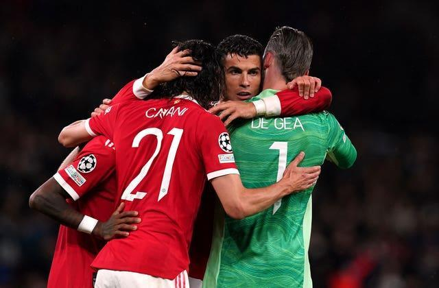 Cristiano Ronaldo is mobbed by his team-mates