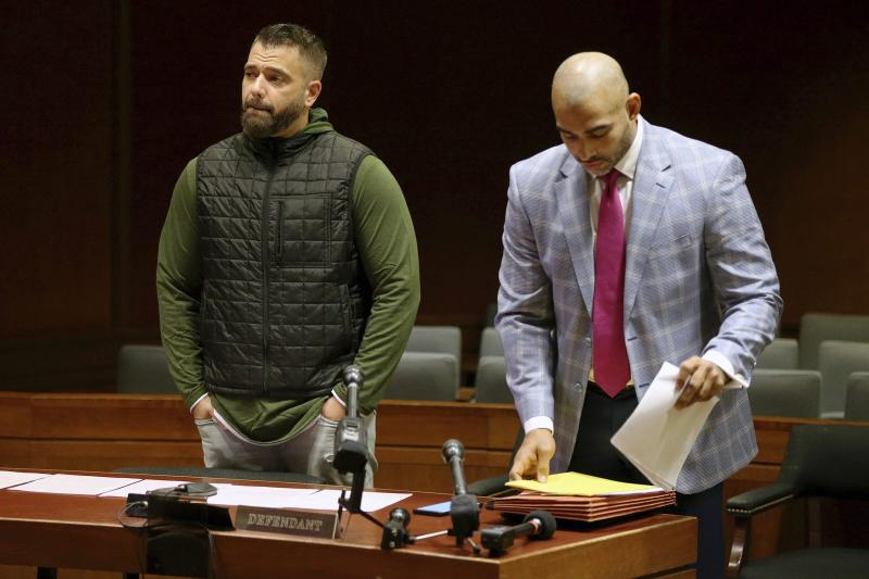 Mark D'Amico, left, stands with his lawyer, Mark Davis, as he prepares to plead guilty to one count of misappropriating entrusted funds in Burlington County Superior Court in Mount Holly, N.J., on Friday, Dec. 6, 2019. Along with his then-girlfriend, Kate McClure, and a homeless man, Johnny Bobbitt, D'Amico allegedly set up a false online fundraiser and kept the money for themselves.  (Tim Tai/The Philadelphia Inquirer via AP)