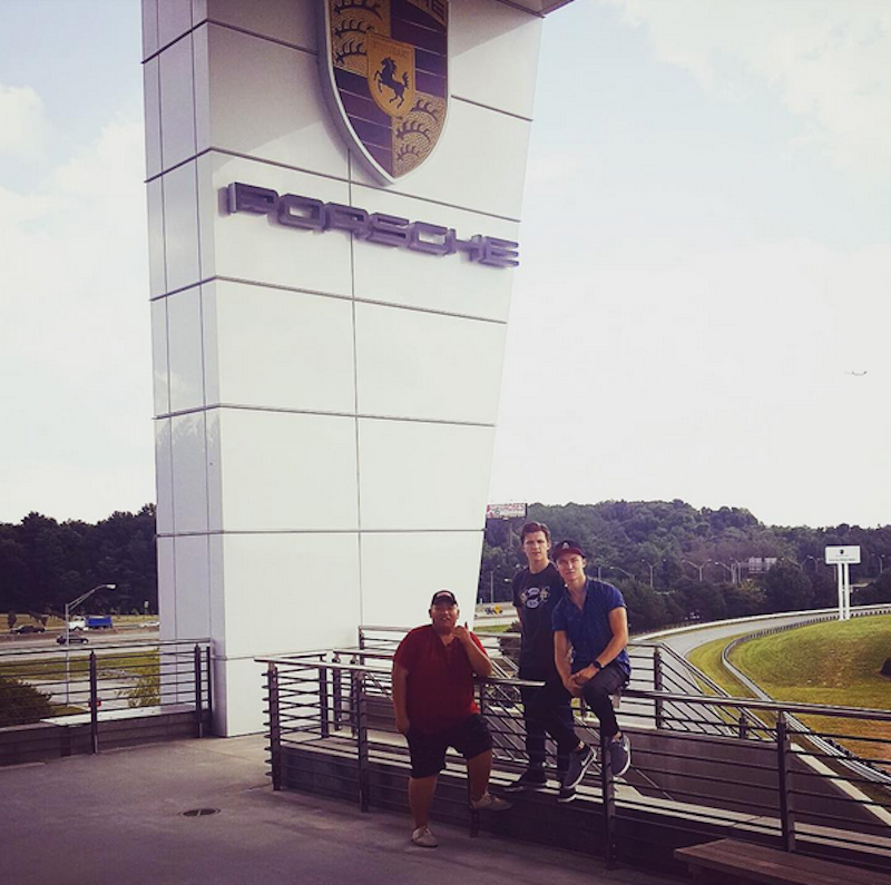 """<p>Holland, co-star Jacob Batalon and friend Harrison Osterfield pose at Porsche HQ in Atlanta. Because the caption of this Sept. 15 photo is """"The A team!"""" and the Porsche site doubled as the Avengers base in recent movies, <a href=""""https://www.yahoo.com/movies/spider-man-homecoming-does-tom-hollands-field-trip-to-avengers-country-suggest-plot-point-184700461.html"""" data-ylk=""""slk:there's speculation;outcm:mb_qualified_link;_E:mb_qualified_link;ct:story;"""" class=""""link rapid-noclick-resp yahoo-link"""">there's speculation</a> that Spidey might pay a visit to some of Earth's mightiest in 'Homecoming.'<i> (Photo: <a href=""""https://www.instagram.com/p/BKYu63mDVZL/"""" rel=""""nofollow noopener"""" target=""""_blank"""" data-ylk=""""slk:Tom Holland/Instagram"""" class=""""link rapid-noclick-resp"""">Tom Holland/Instagram</a>)<br></i></p>"""