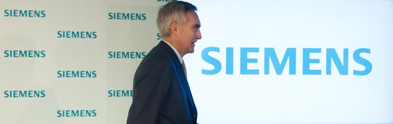 """FILE - In this Jan. 24, 2012 file picture CEO of Siemens AG Peter Loescher leaves a press conference in Munich, Germany.German engineering giant Siemens AG says it will be replacing its chief executive, who has drawn the ire of shareholders by failing to meet profit targets. Siemens said in a statement late Saturday July 27, 2013 that its board will meet Wednesday to """"decide on the early departure of the president and CEO"""" Peter Loescher. Siemens is a heavyweight in Germany's engineering industry with interests in high-speed rail, advanced medical technology, robotics and power generation. (AP Photo/dpa,Peter Kneffel,File)"""