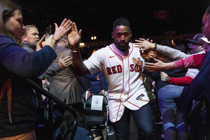 Boston Red Sox center fielder Jackie Bradley Jr. greets fans on his way to the stage during the baseball team's fan fest Friday, Jan. 17, 2020, in Springfield, Mass. (Leon Nguyen/The Republican via AP)