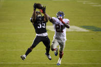 Philadelphia Eagles' Boston Scott, left, catches a touchdown pass against New York Giants' Jabrill Peppers during the second half of an NFL football game, Thursday, Oct. 22, 2020, in Philadelphia. (AP Photo/Derik Hamilton)