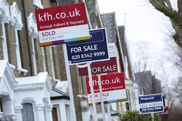 Library file photo dated 28/02/14 of for Sale signs displayed outside houses in Finsbury Park, North London. House prices lifted by 9.4% year on year in February as consumer confidence continues to grow, Nationwide has reported. PRESS ASSOCIATION Photo. Issue date: Friday February 28, 2014. See PA story ECONOMY House. Photo credit should read: Yui Mok/PA Wire