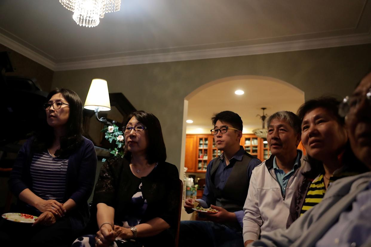 People in Little Neck, New York, watch a news report on the summit between the U.S. and North Korea.