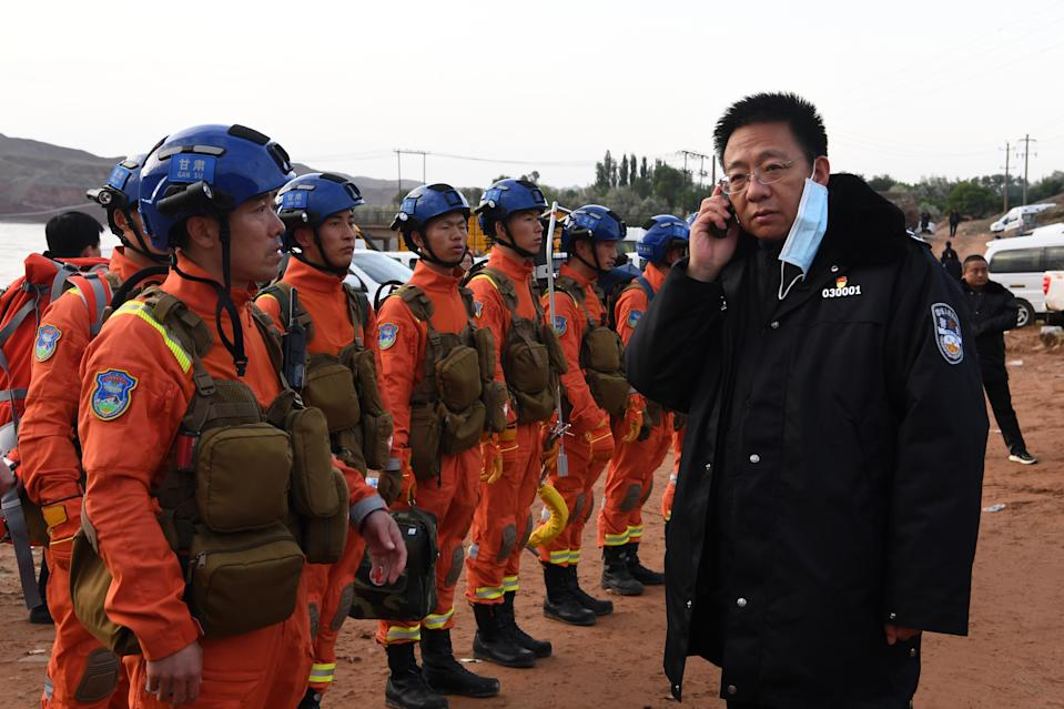 Rescuers discuss the details to search for survivors in Jingtai County of Baiyin City, northwest China's Gansu Province, after sudden extreme weather during a mountain race. (Fan Peishen/Xinhua via Getty Images)