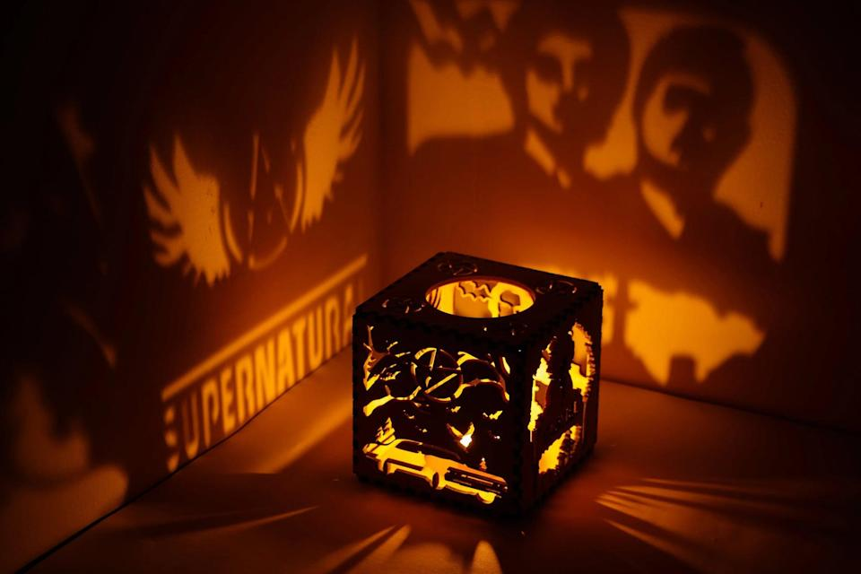 <p>Spruce up their space with this <span><strong>Supernatural</strong> Engraved Wooden Candle Lantern</span> ($17 and up). It'll give their room an eerie, <strong>Supernatural</strong>-worthy ambience. </p>