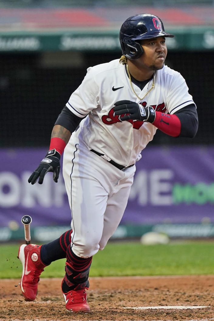 Cleveland Indians' Jose Ramirez watches his two-run double during the sixth inning of the team's baseball game against the Cincinnati Reds, Saturday, May 8, 2021, in Cleveland. (AP Photo/Tony Dejak)