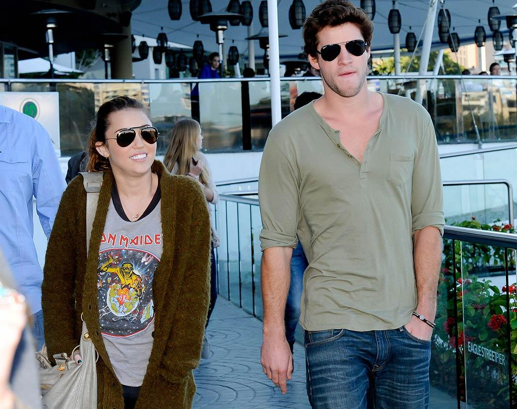 """Miley Cyrus and Liam Hemsworth """"are so devoted to each other,"""" reports <i>Star</i>, that friends and family are """"hearing wedding bells."""" The mag says the Cyrus and Hemsworth clans were """"one big happy family"""" when the singer recently toured in her boyfriend's native Australia, and now their loved ones are certain """"Miley and Liam will take the next step and get engaged."""" For details about when and how Hemsworth will pop the question, log on to <a href=""""http://www.gossipcop.com/miley-cyrus-getting-married-liam-hemsworth-wedding-parents-engaged-engagement/"""" target=""""new"""">Gossip Cop</a>. Scope Australia/<a href=""""http://www.PacificCoastNews.com"""" target=""""new"""">PacificCoastNews.com</a> - June 22, 2011"""